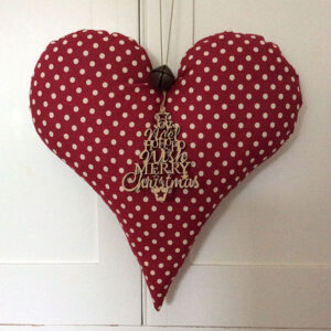 Polka dot red fabric heart made by Kaye Webber